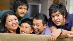 Happy Asian family in the livingroom